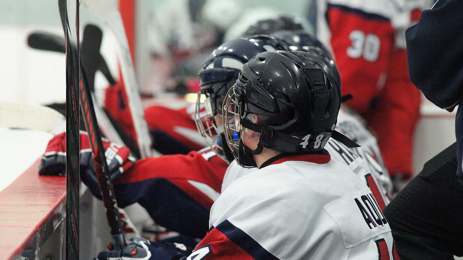 Players on the bench at a bantam hockey tryout
