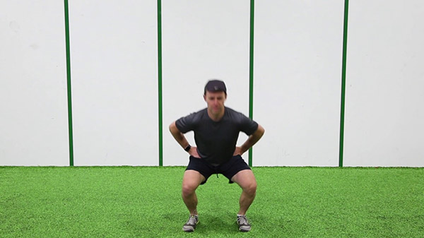 Squat hold for 5 seconds and jump