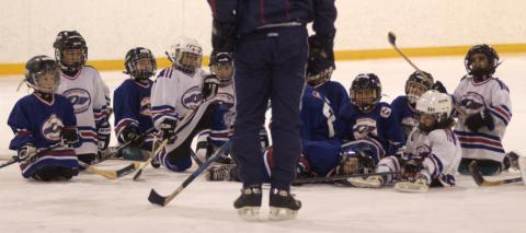 hockey coach with kids